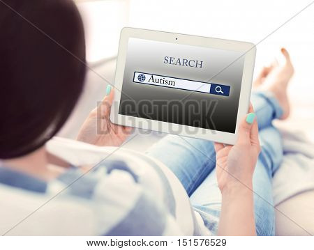 Pregnant woman with tablet. Children autism concept