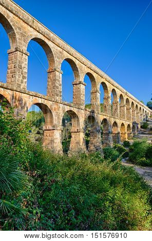Hugo roman aqueduct construction in the park near Tarragona, summer Spain