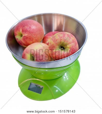 Kitchen Electronic Scales Weigh Several Red Apples.