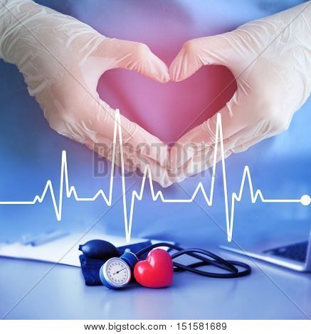 Heart beat line and doctor hands in gloves making heart shape. Cardiology and health care concept.