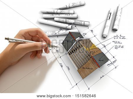 Hand sketching on an Architecture model with blueprints