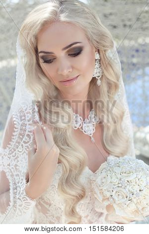 Closeup Wedding Portrait Of Gorgeous Bride. Beautiful Blond Woman With Long Wavy Hair Style And Make