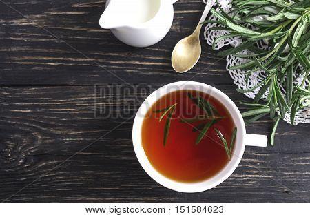 Rosemary Tea And Milk Jar On Wooden Table.