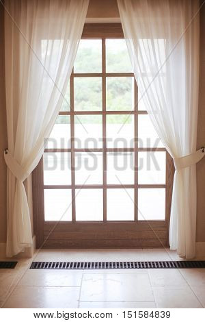 wooden window frame with white curtain, door