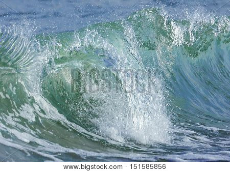 Marine, transparent waves in the coastal zone.