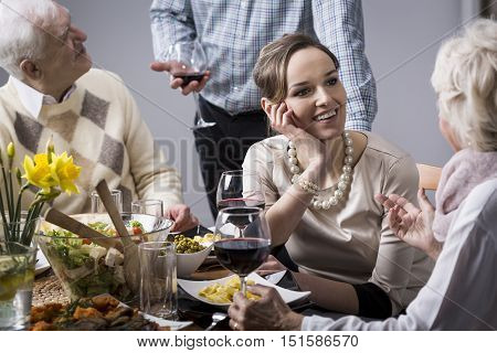 Woman Chatting At The Dinner Table