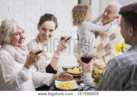 Family Raising Glasses In A Toast
