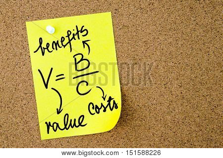 Value Is Benefits Per Costs Formula Written On Yellow Paper Note