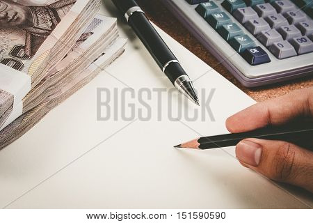 Business Money Desk Concept. Calculator, Pen And Money On Desk With Copy Space For Text. Hand Holdin
