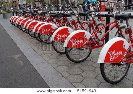 Barcelona, Spain - 24 September 2016: Bicycle rental stand Viu Bicing Barcelona. Rental stand with bicycles opposite Casa Mila - La Pedrera in Barcelona, Spain.