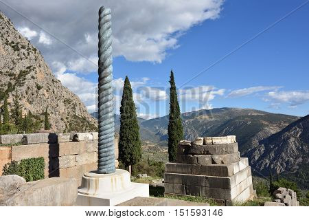 Ancient column in Ancient Greek archaeological site of Delphi Central Greece