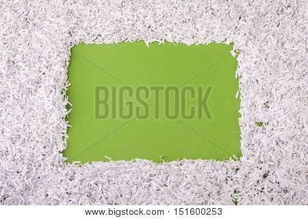 green background with shredded paper frame around