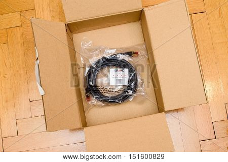 PARIS FRANCE - SEP 12 2016: Amazon Premium Red and High quality Duronic FTP CAT6a Black digital computer cable ethernet rj45 on top of Amazon Prime cardboard box after unboxing