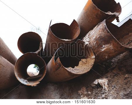 Fragments Of Old Large Water Pipes. After Many Years Of Operation, Corroded Metal Pipe Destroyed. Ru