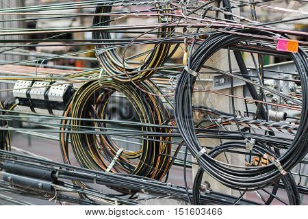 close up of tangle electric wire at Bangkok , Thailand . shallow depth of field , selective focus at pole.