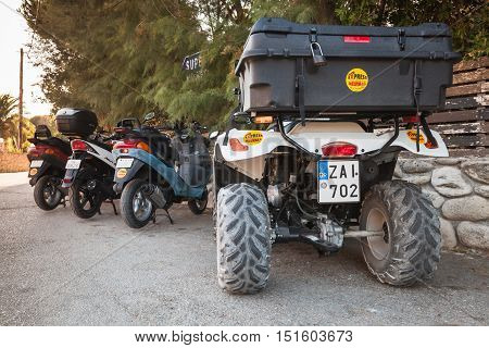 Atv Quad Bike And Scooters On Parking