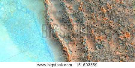 Allegory, waves in the desert, sea and sand in the desert, abstract landscapes of deserts, abstract photography deserts of Africa from the air,