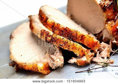 juicy grilled meat on a plate on a light background