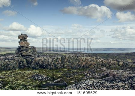 Top of the mountain overlooking sea in sunny day. Arctic summer the tundra Norway.