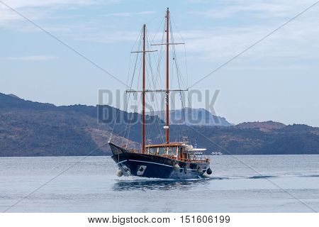 A sailing vessel designed for marine excursions on the raid Athinios port. Santorini. Greece.
