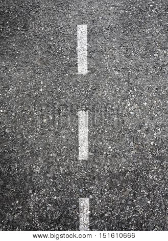 Roadway background with white dashed dotted line marking
