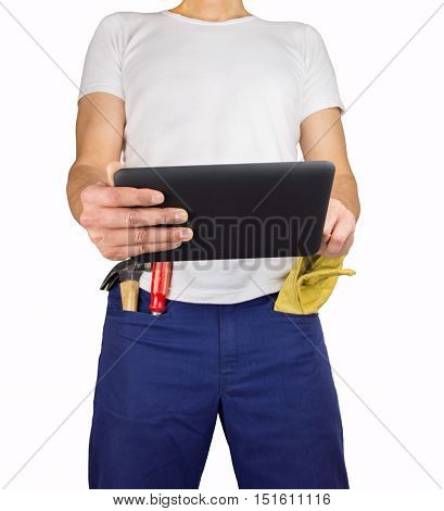 professional worker of building holding tablet pc with tools in the pocket over white background