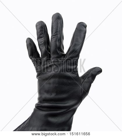 hand of robber with black glove with white background