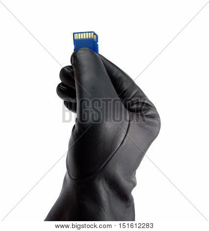 hand in black glove holding the memory card with stolen data