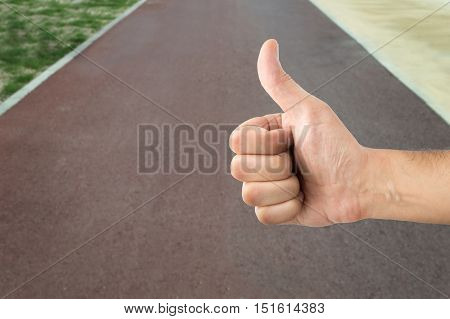 positive hand on of victory in race