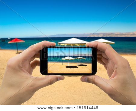 taking a photo of the beach with the smartphone