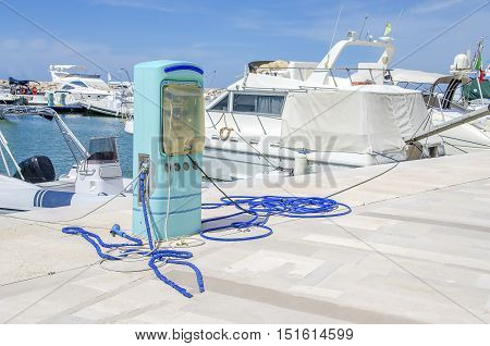 gas station harbor power supply marina blue pump pier white