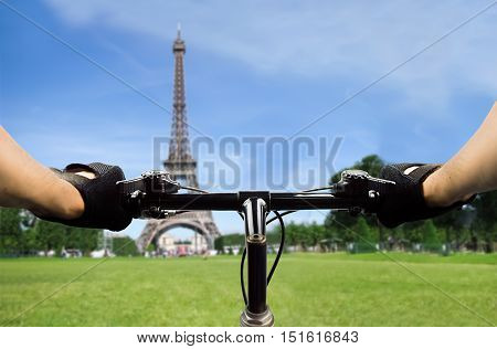 closeup of a handle of a bicycle in Paris