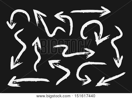 Set of white arrows painted with a brush. Grunge. Thirteen elements isolated on black background.