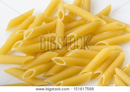 italian penne rigate isolated on white background close up