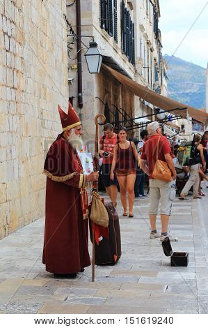 DUBROVNIK, CROATIA - SEPTEMBER 8, 2016: It is an unknown person who wears medieval Catholic priest.