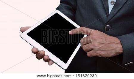 Man holding a tablet computer front view. iPad Pro was created and developed by the Apple inc.