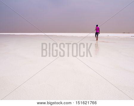 AFAR REGION ETHIOPIA - JUNE 26 2016: Tourist visiting salt desert and lake in the Afar Region Danakil Depression Ethiopia.