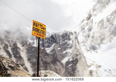 Way to Mount Everest Base Camp signpost in Himalayas. Inspirational Mountain Landscape in Nepal
