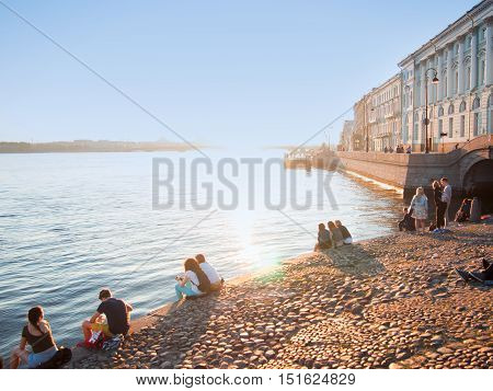 SAINT PETERSBURG, RUSSIA - March 07, 2016: Waterfront of the Neva river, people relax and greet the dawn, white nights