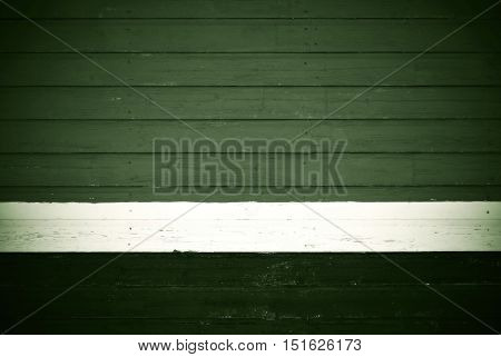 old wooden boards green color texture and background and white strip