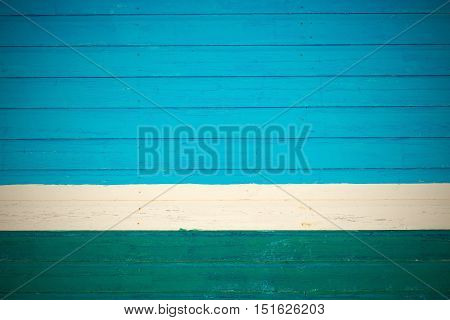 old wooden boards pale blue green color texture and background and white strip