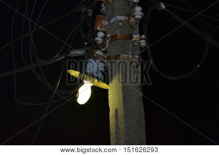 Lightning pillar with wires from electricity and telephony