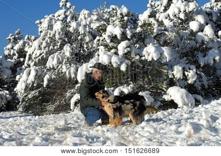Dog Lover Plays In Snow With Pets