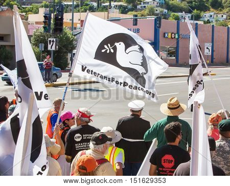 Rear View Of Protestors Marching Toward Border