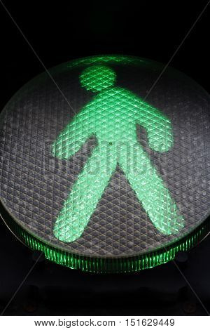 green traffic sign for pedestrians, traffic rules