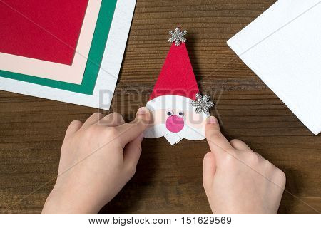 Creating a Christmas decoration for table setting. Decor for serviette in form of Santa Claus. Children project step by step photo instructions. Step 6. The final design of the face of Santa Claus