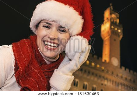 Woman In Christmas Hat Near Palazzo Vecchio Having Fun Time