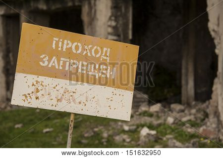 prohibiting the banner at the ruins of the hospital after the war