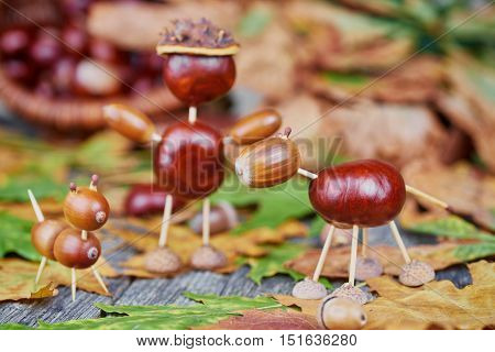 Small creatures made of chestnuts and acorns. Autumnal decoration