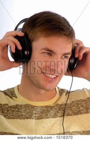 Young Guy In Headphones